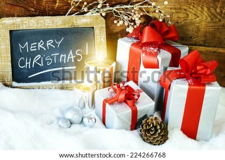 Christmas gift box with christmas balls and candles - stock photo