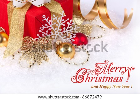 Christmas gift box with christmas balls in snow - stock photo