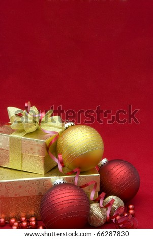 Christmas gift box with christmas balls on red background