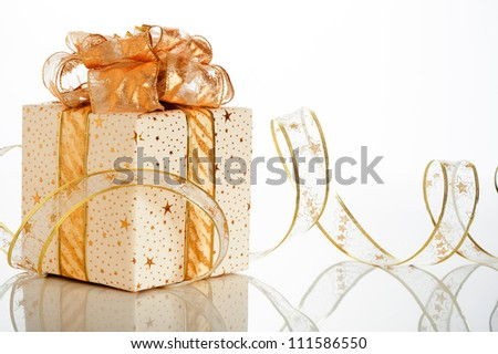Christmas gift box with decoration on white background - stock photo