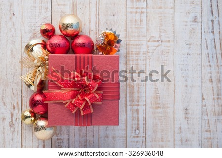 Christmas gift box with decorations and color ball on vintage white wood background - stock photo