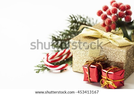 Christmas gift box with decorations on white background