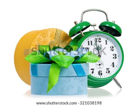 Christmas - gift box with green alarm clock - stock photo