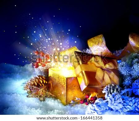 Christmas Gift Box with miracle. Magic Stars and Light. Winter Holiday Art Background with Snow and Gifts. Present Box. New Year Open gift box and magic light fireworks - stock photo