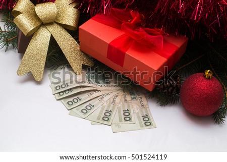 christmas gift box with polish pln money on white background