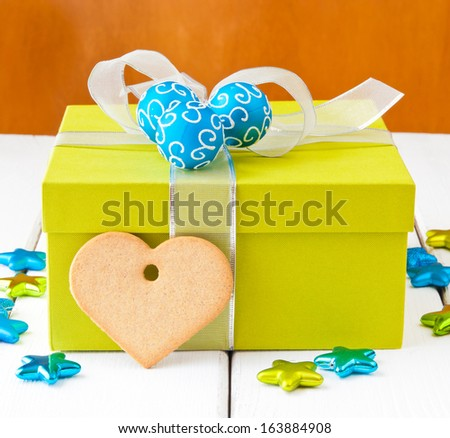 Christmas gift box  with silver bow and  blue bauble cluster. selective focus, shallow dof - stock photo