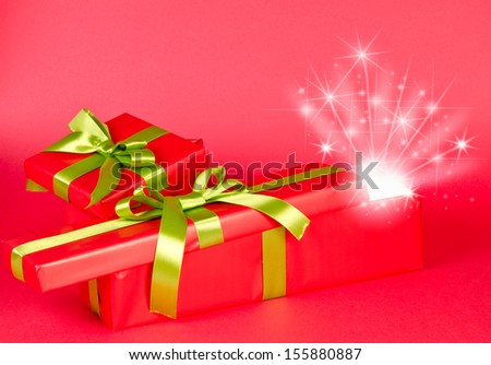 Christmas gift box with surprise, light and stars.