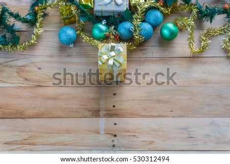 Christmas gift boxes and decoration on the old dark board