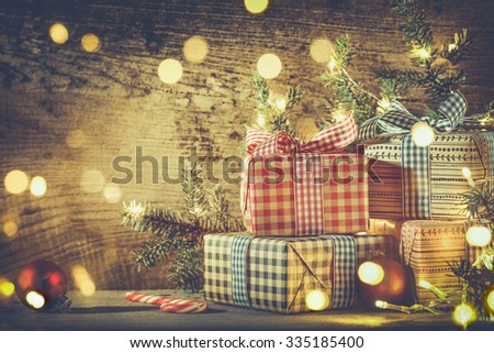 Christmas gift boxes and decorations on wooden background  - stock photo
