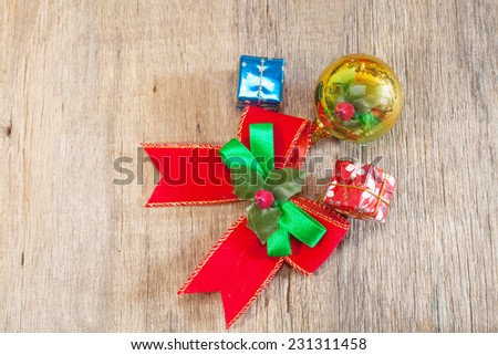 Christmas gift boxes and ribbon over wooden background