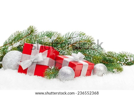 Christmas gift boxes and snow fir tree. Isolated on white background with copy space - stock photo