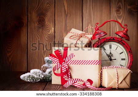 Christmas gift boxes, fir tree and alarm clock - stock photo