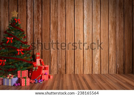 Christmas gift boxes in wooden room - stock photo