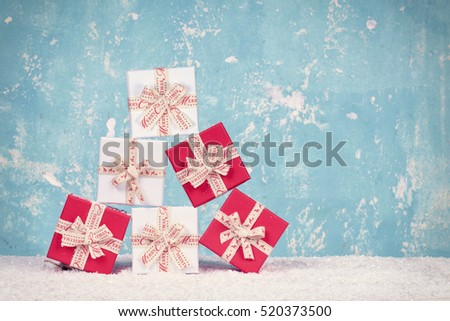 Christmas gift boxes on blue Background, red and White Christmas boxes