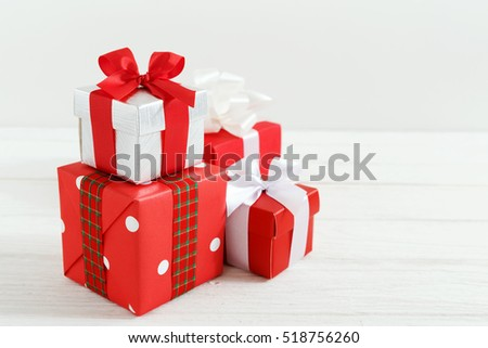 Christmas gift boxes on white wood table background