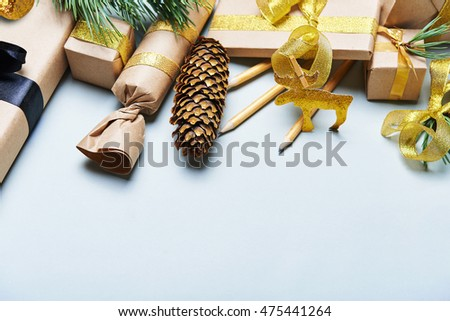 christmas gift boxes wrapped in craft paper. With golden accessories.  place for text