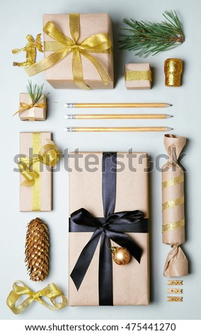 christmas gift boxes wrapped in craft paper. With golden accessories. Top view. Flat lay