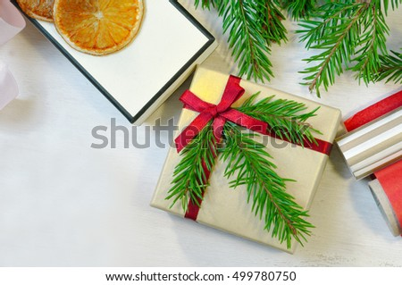 Christmas gift decorated with Christmas tree twig, christmas tree branches. Christmas mood photo. Christmas card. Christmas symbol. Preparing to Christmas. Christmas celebration. Christmas background