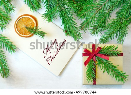 "Christmas gift, envelope with  inscription ""Merry Christmas""  christmas tree branches. Overhead view. Christmas mood photo"