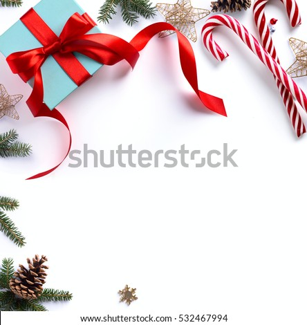 Christmas gift, fir tree branches and Christmas ornament on white background. Flat lay, top view.