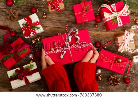 Christmas gift giving someones hand holding stock photo royalty christmas gift giving someones hand holding red christmas gift boxes on wooden background negle Gallery