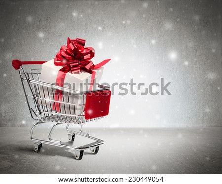 christmas gift in cart - wall and snow  - stock photo