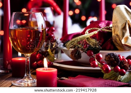 Christmas gift in dishware at the wooden table - stock photo