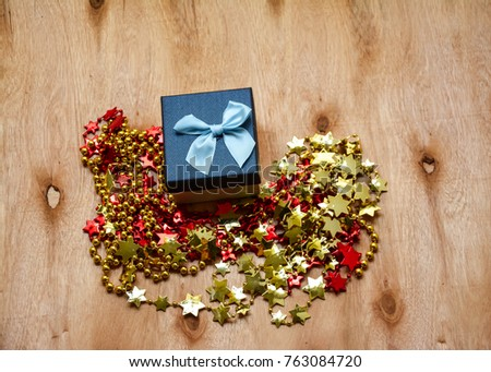 Christmas gift on wooden table with Christmas decoration
