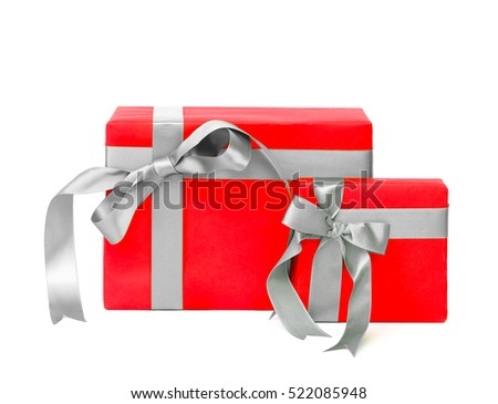 Christmas gift red box with silver color bow isolated on white background