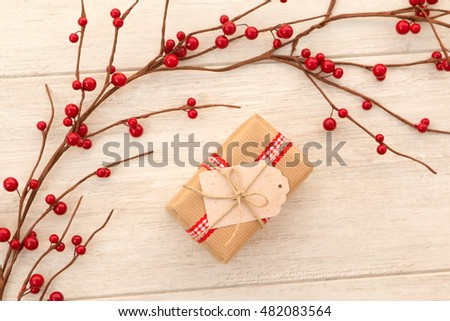 Christmas gift with a nice red fruit Christmas ornament