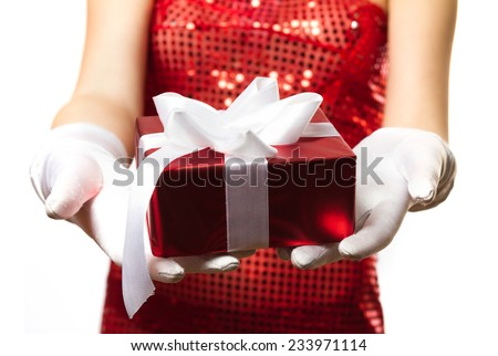 Christmas gift with bow in hand woman isolated on white background - stock photo