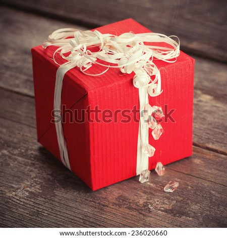 Christmas gift with decoration on wood table - stock photo