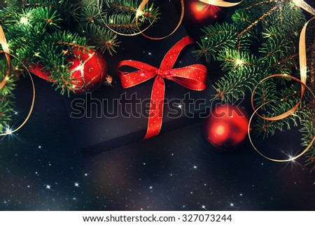 Christmas gift with ribbons and bows under the tree. - stock photo