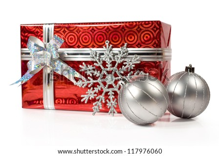 Christmas gift with silver balls isolated on white - stock photo