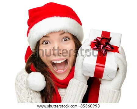 Christmas gift woman isolated. Happy excited santa woman showing christmas prensent isolated on white background. - stock photo