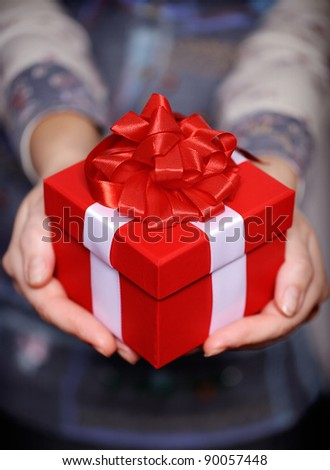 Christmas. Gift woman showing beautiful red gift box. - stock photo
