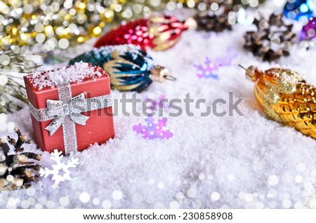 Christmas gifts amid the snow and decorations