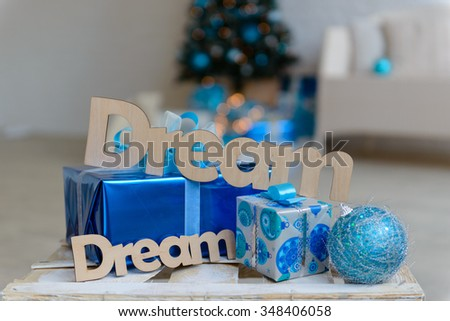 Christmas gifts and a fir-tree. It can be used as a background