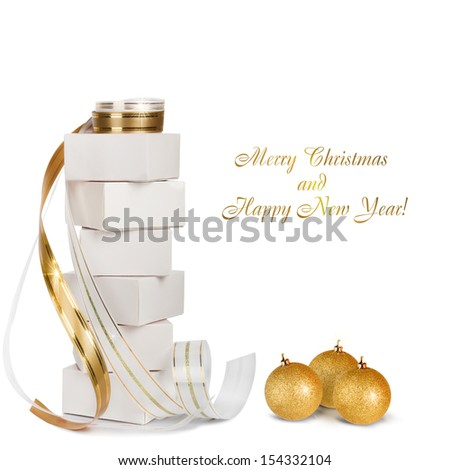 Christmas gifts and balls with gold ribbon isolated on a white background - stock photo