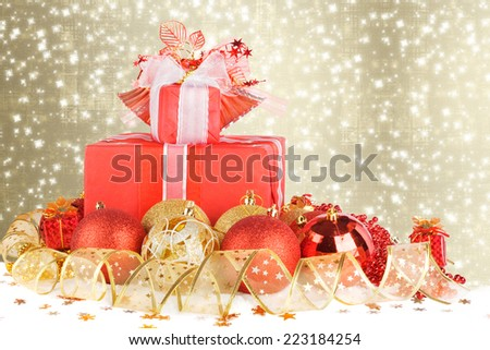 Christmas gifts and balls with gold ribbon on a beautiful abstract background - stock photo