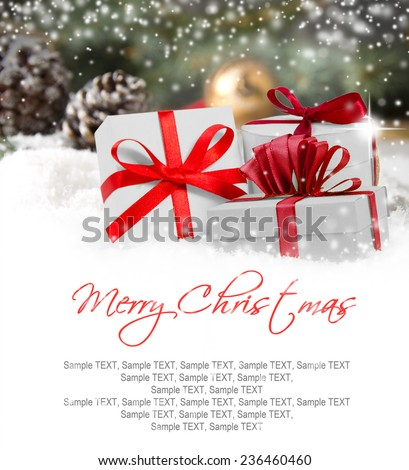 Christmas gifts and cones covered by snow with white space for the text - stock photo
