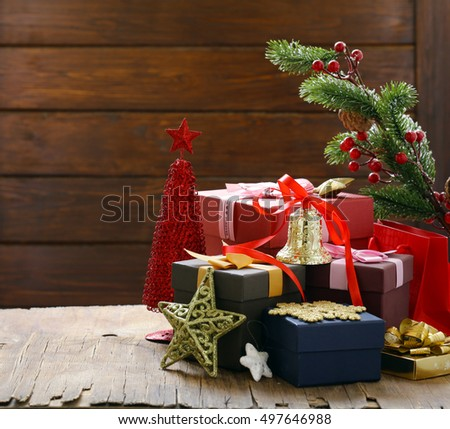 Christmas gifts and decorations on a wooden background, festive still life