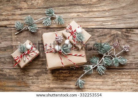 christmas gifts and decorations on wooden background
