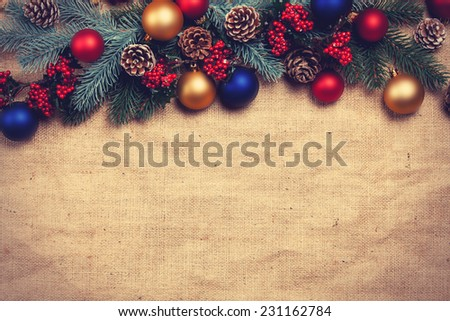 Christmas gifts and pine branches. - stock photo