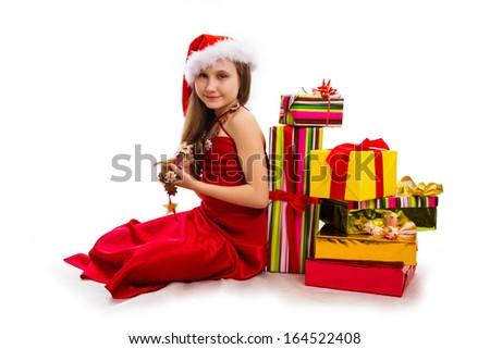 Christmas gifts and small girl Santa - stock photo