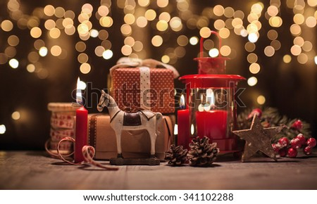 Christmas gifts and toys on bokeh effect background. Christmas decorations - stock photo