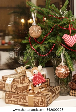 Christmas gifts decorated with paper and textile in gold color