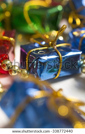 Christmas gifts decoration on a light wooden surface