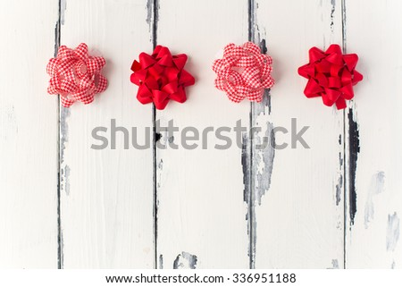 christmas gifts decorations bows in a row with copy space - stock photo