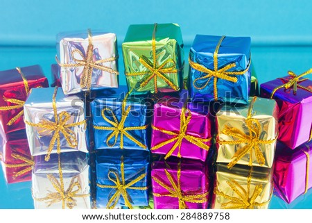 Christmas gifts on a blue background - stock photo